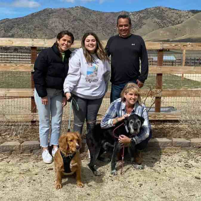 Henry the senior dog with his forever family