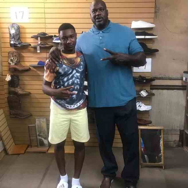 Shaquille O'Neal and Zach Keith inside a Friedman's Shoes store