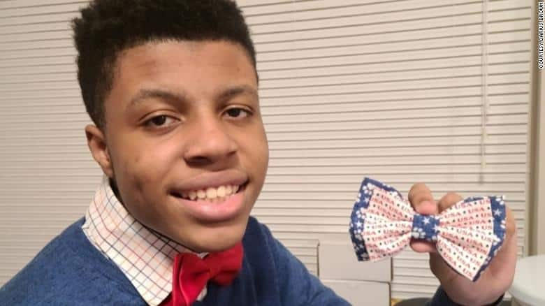 Darius showing one of his bow ties.