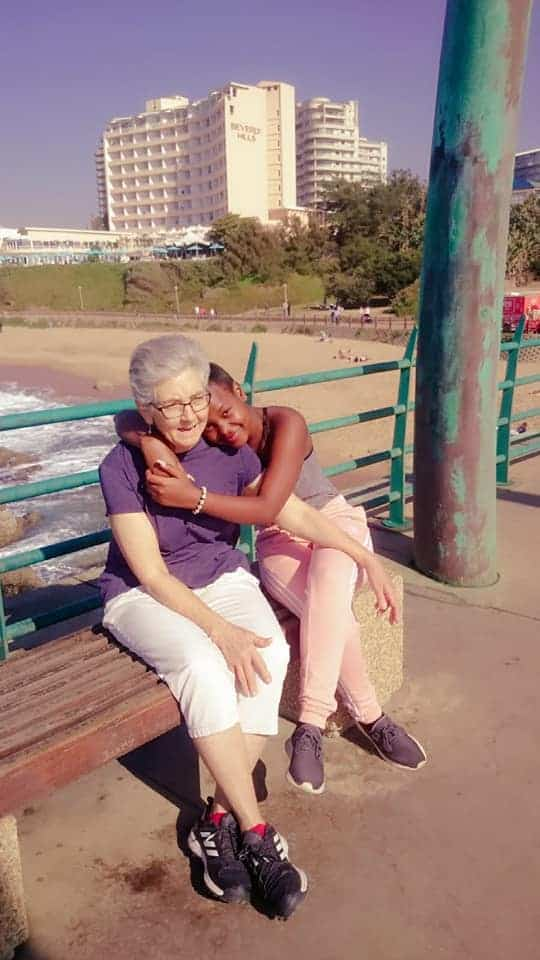 Mandisa Mlitwa hugging her adoptive mother
