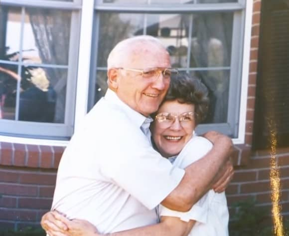 Kay Andrews and Wade Andrews hugging each other