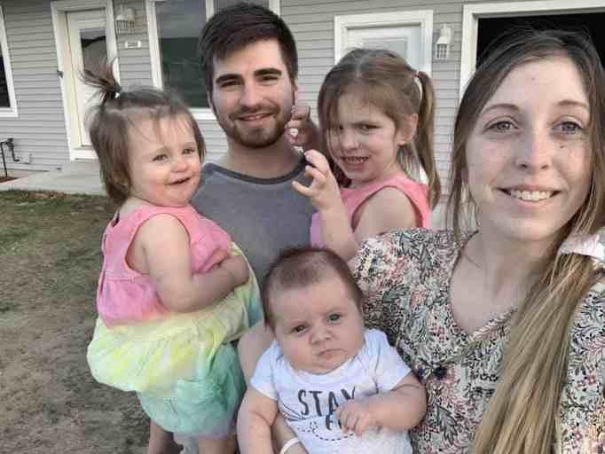 Alyssa DeWitt with her husband and three children
