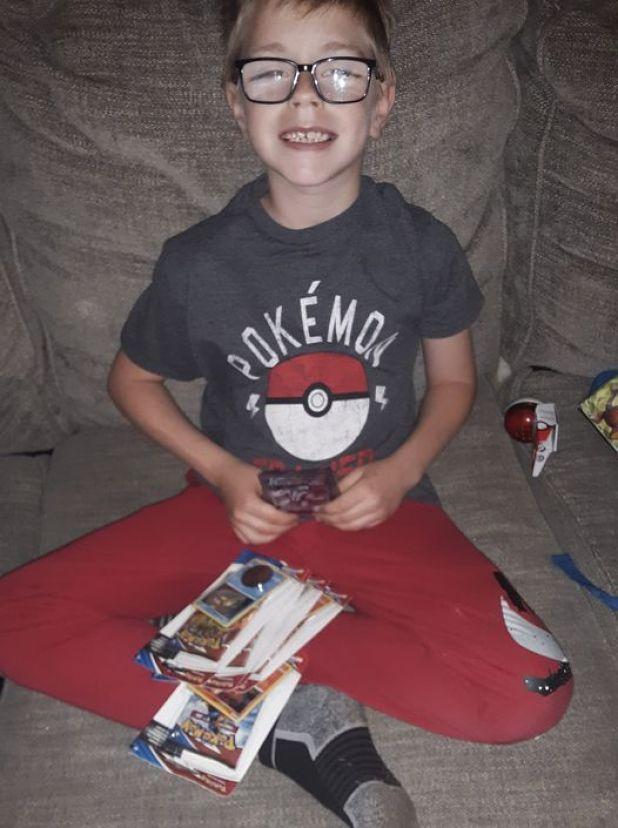 Bryson Kliemann with his Pokemon cards