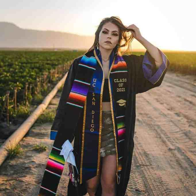 Jennifer Rocha in her graduation cap and gown