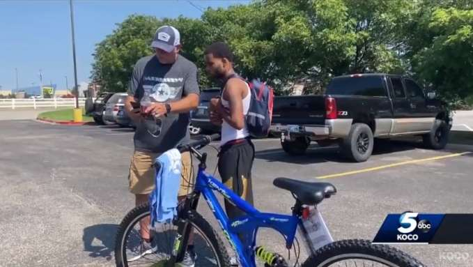 Michael Lynn and Donte Franklin with his new bike
