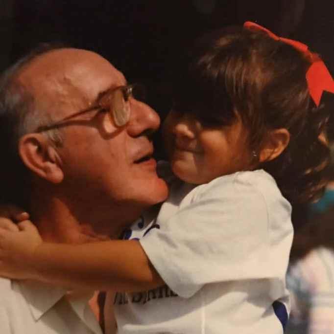 Little girl hugging grandpa