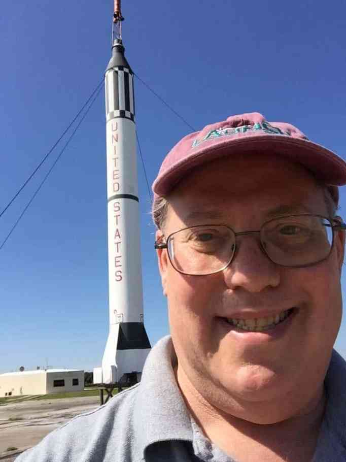 Steve Kristal with a replica of the Mercury-Redstone 3 behind him