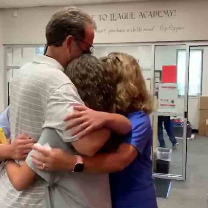 The Powells in a group hug