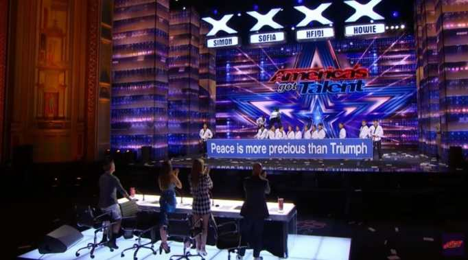 Judges standing up after the World Taekwondo Demonstration Team performance on AGT free auditions.
