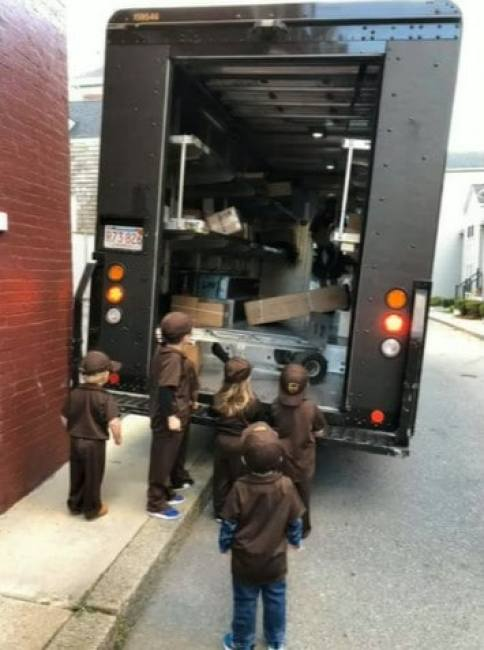 Kids dressed up as a UPS driver