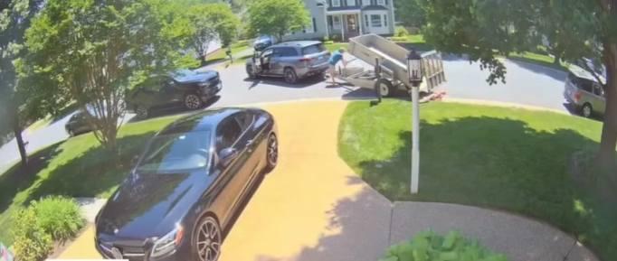 A man dumping pennies onto a lawn