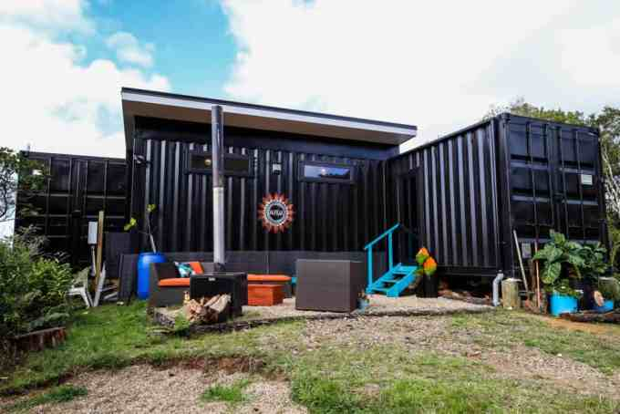 This shipping container has an industrial look the owner prefers.