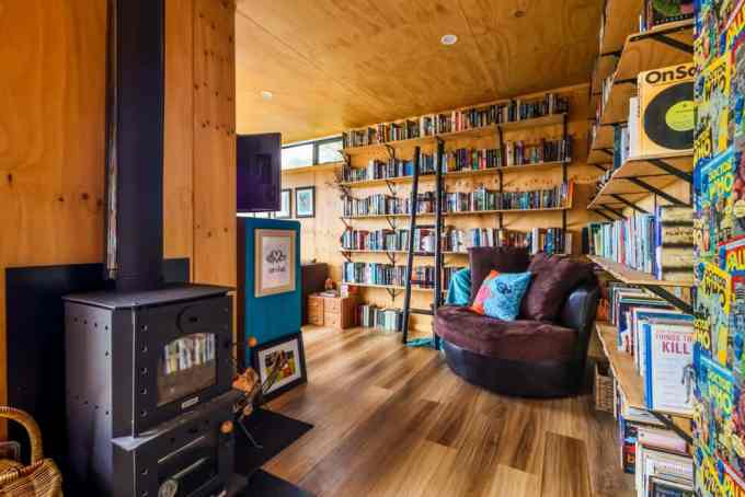 Her off the grid home comes with its own library