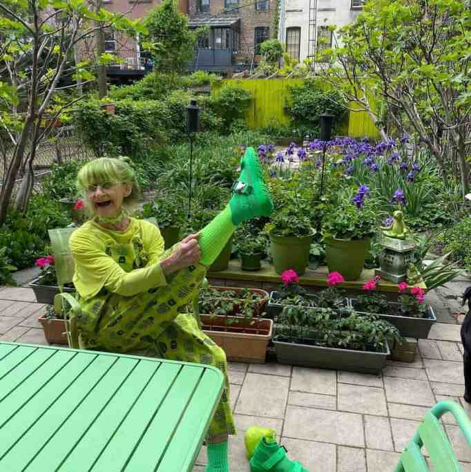 Sweetheart tries out new green shoes in her garden.
