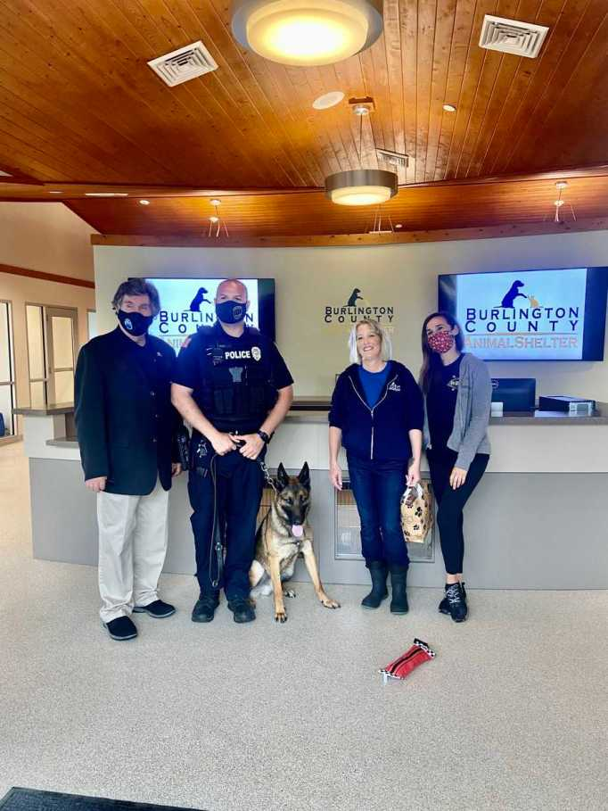 Dan O'Connell, Officer Kyle Heasley, Debbie Bucci, Angela Connor, and Arrow at Burlington County Animal Shelter