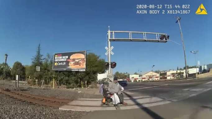 An elderly man on a wheelchair