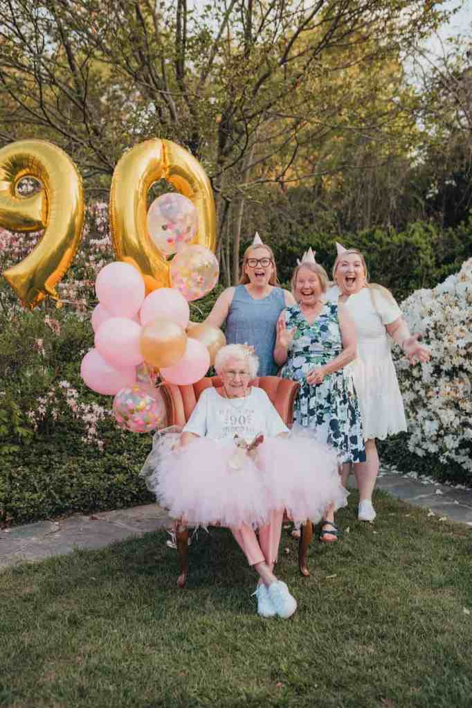 A grandma with her daugther and two grandaughters during her 90th birthday