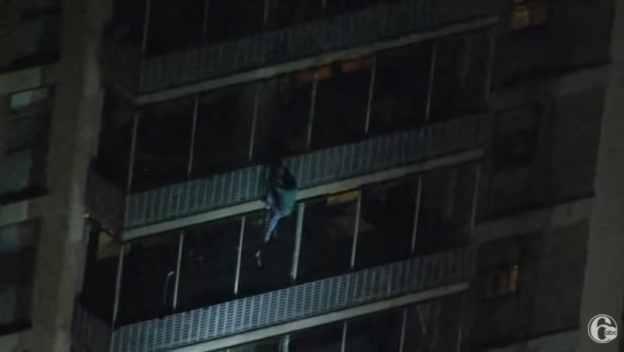 Jermaine climbing down an apartment building