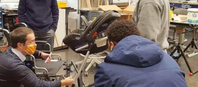 Bullis School students working on the wheelchair stroller