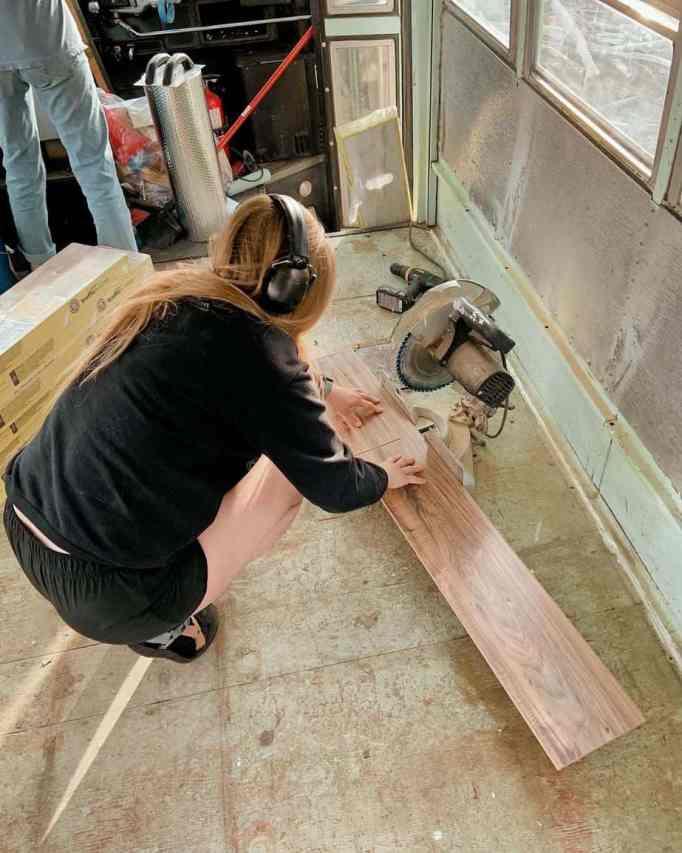 A woman cutting wood