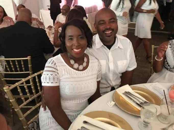 Tia Wimbush and Rodney Wimbush wearing white outfits