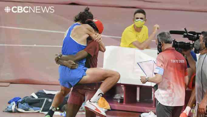 Gianmarco Tamberi and Mutaz Barshim hugging each other after their Olympic gold win