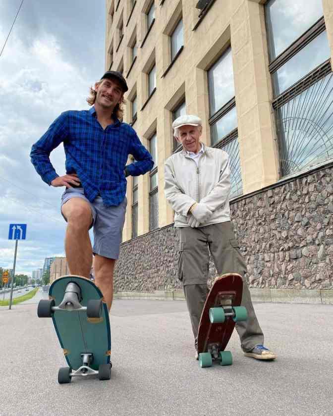An elderly man skateboarding in Russia