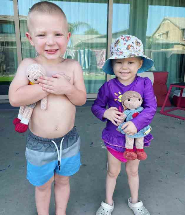 Mack Porter and Payson Altice wearing their swimming gear