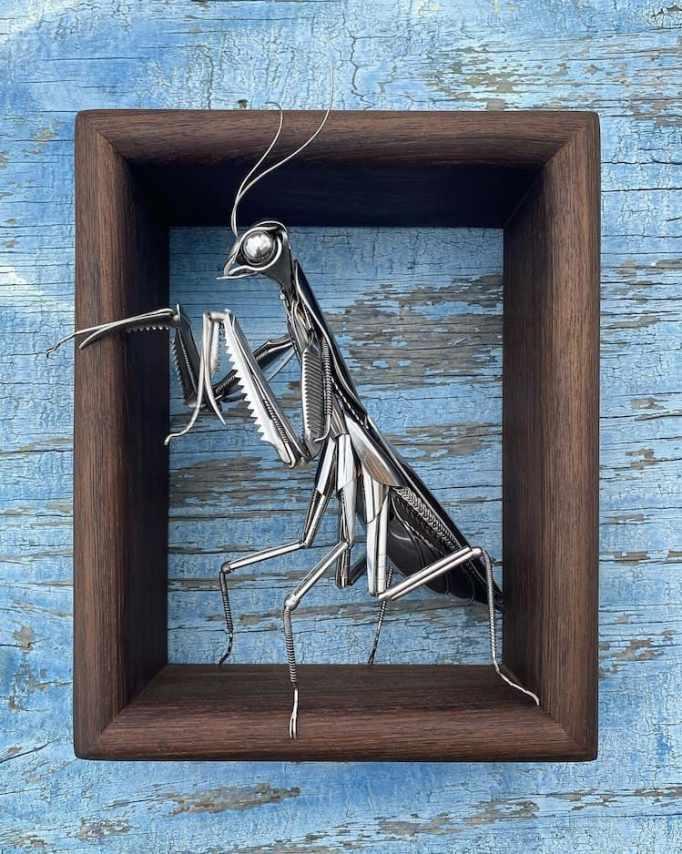 A praying mantis sculpture made from metal