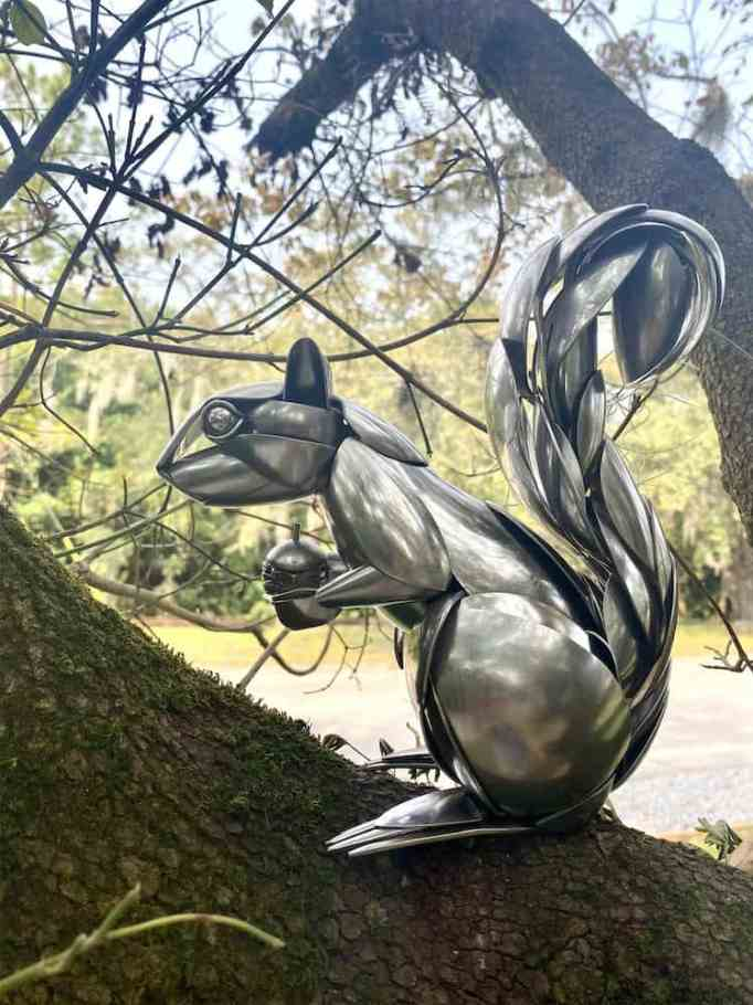A squirrel sculpture made from metal