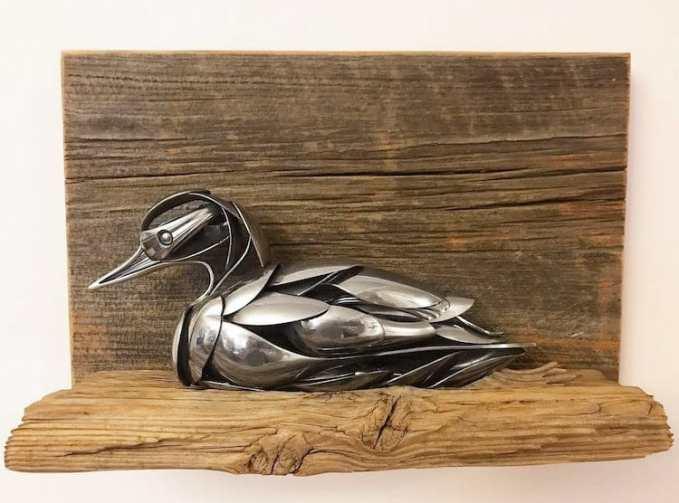 A bird sculpture made from metal