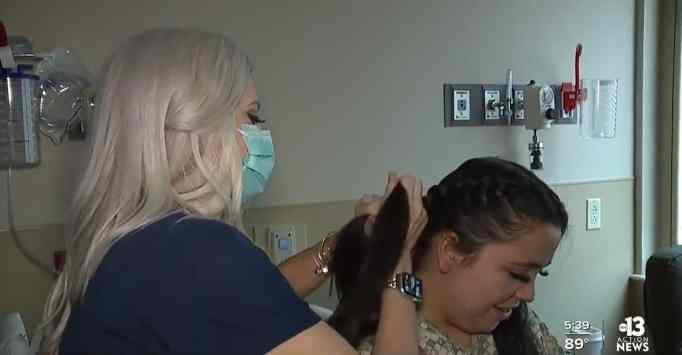 Nurse Brooke Johns braiding a patient's hair