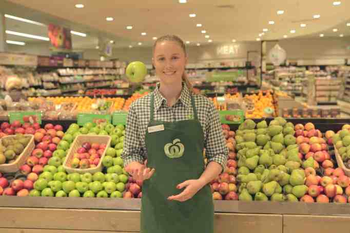 Riley Day working at Woolworths supermarket