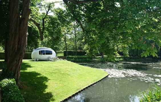 The Ecocapsule by a pond
