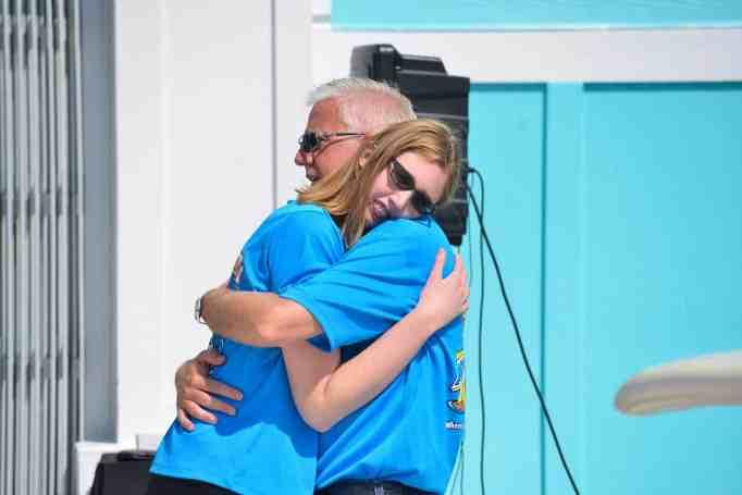 Gordon and Morgan sharing a warm hug