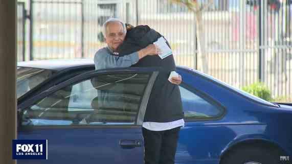Jose Villaruel hugging Steven Nava