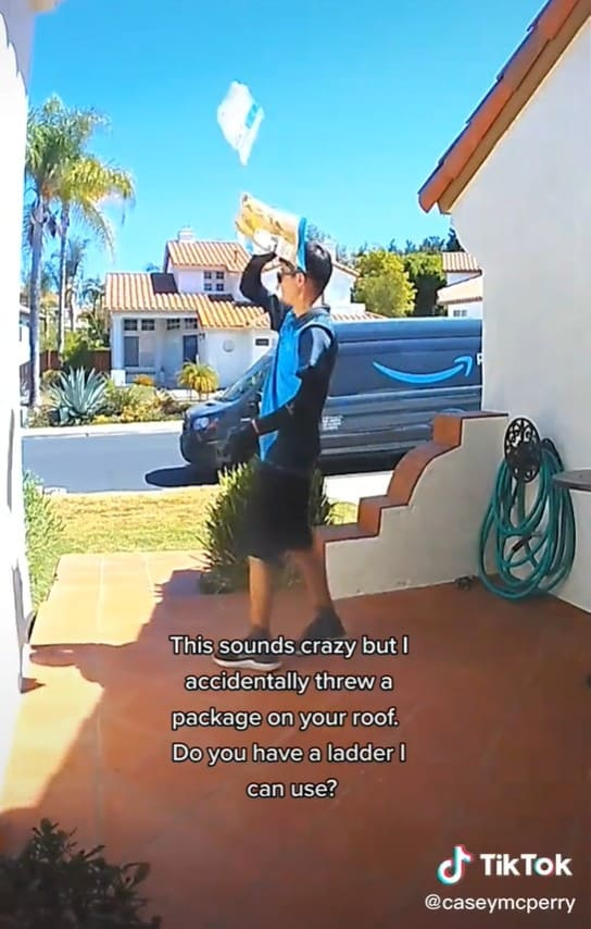 Amazon delivery driver accidentally tossing a package onto the roof