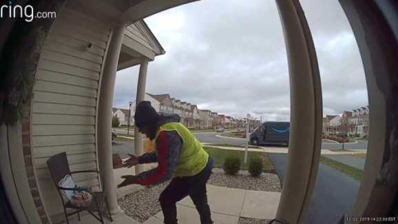 Amazon delivery driver looking at refreshments on a porch chair