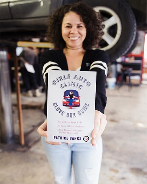 """Patrice Banks holding her book """"The Glove Box Guide"""""""