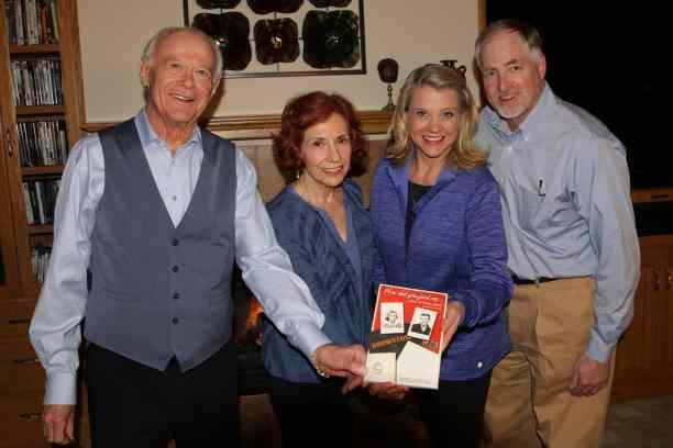 "Dennis Vinar, Karen Lehmann, Jean Voxland, and Andrew Voxland holding the ""How Did You Find Me?"" book"