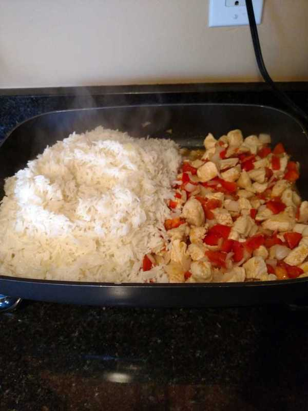 Rice added to chicken and vegetables