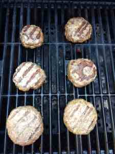 Low Carb BBQ Cheddar Burgers cooking on the grill