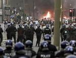 Police battle rioters on the streets of the UK
