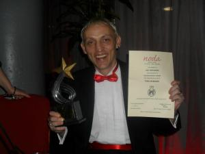 Mike Clarke shows off SMTC's Best Panto Award