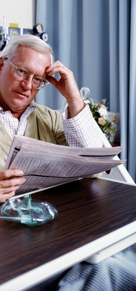hospital patient reading newspaper