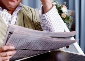 hospital patient reading newspaper