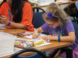 child working on STEAM project at Kids Camp Jax