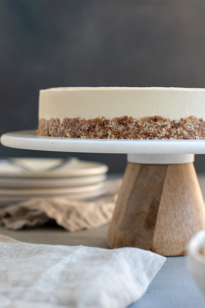 straight on view of cheesecake on a cake stand