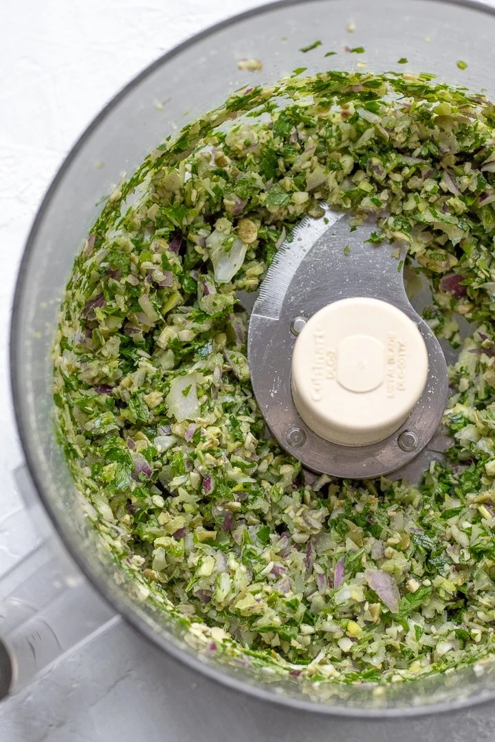 Onion, garlic, parsley, mint and pumpkin seeds chopped up in a food processor