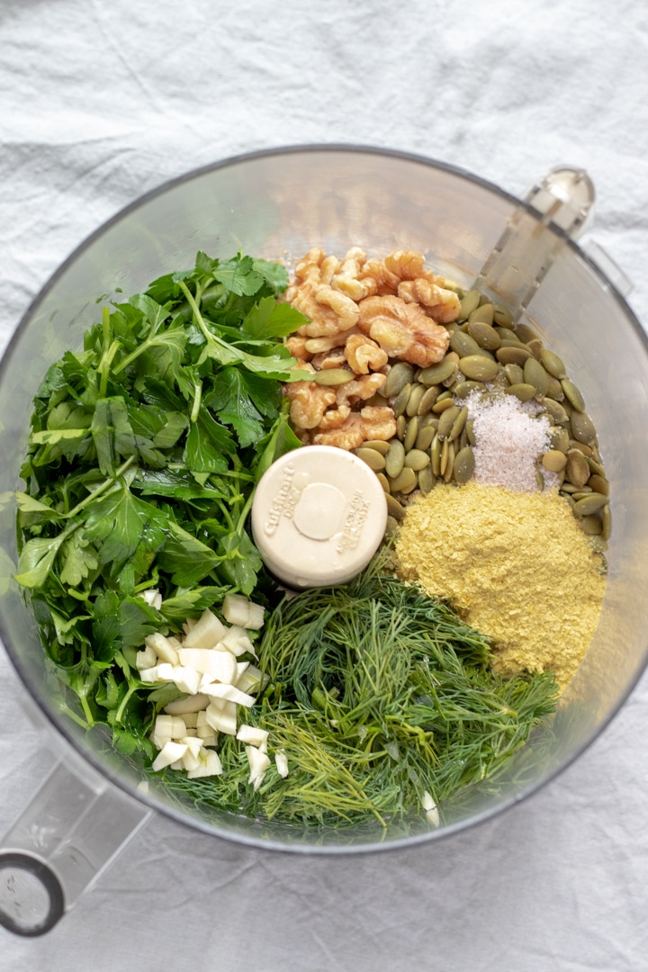 pesto ingredients in bowl of food processor